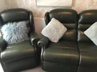 Dark green leather 2 seater sofa and matching chair.