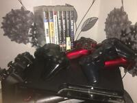 PS3 7 games 5 controllers and my gt bike with upgrades