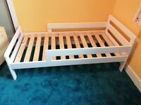 Toddler bed with safety sides