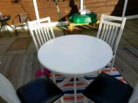 Solid white wood table round extends to oval table with 4 chairs