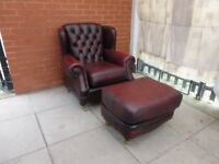An Oxblood Thomas Lloyd Leather Chesterfield Armchair And Pouffe