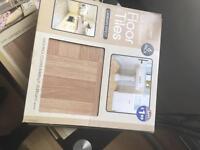 Laminate effect self adhesive floor tiles