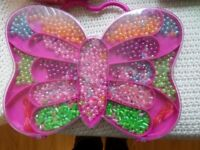 Tesco butterfly carry along toy plastic bead box partially used