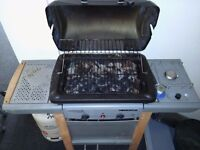 Homebase Campingaz Gas BBQ with nearly full butane gas cylinder. Permanent coals and gas hob.