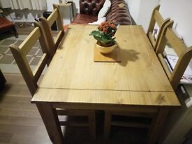 Dining table with four chairs - Good condition
