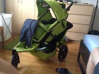 A green Phil & Teds Sport double Pushchair is for sale in Fulham