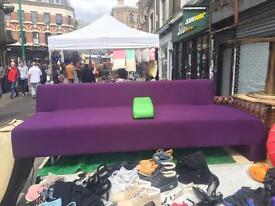 2 large purple sofas and foot rest