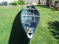 Coleman canadian canoe 3 man with outboard motor.