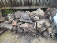 STONES, SOIL WITH SOME ROCKS, GATE, FIRE WOOD, BRICKS.