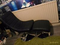 Leather black chair with foot stool