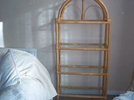 Glass-and-cane shelving unit