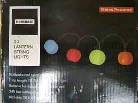 Unused, coloured lantern string lights