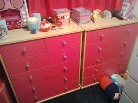 2 x pink chests of drawers