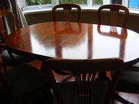 Dining Table and 6 chairs (2 carvers and 4 chairs)