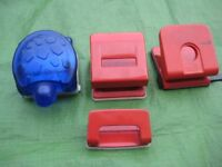 Four Two-Hole Punches of Different Size and Shape