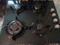 Logik four-burner gas hob, less than a year old, good condition.