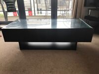 Dark wood coffee table in excellent condition
