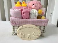 Wicker baby gift basket pink, blue and white