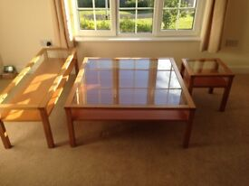 COFFEE TABLES – WOODEN WITH GLASS TOP – SET OF THREE.