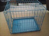 small blue dog cage