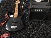 Junior electric guitar with speaker
