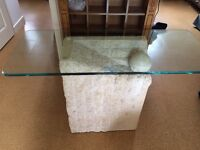 Oblong stone table ideal for hallway with glass top