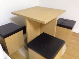 Table with 4 stools storage