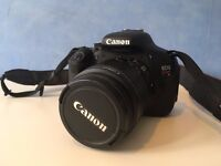 Canon 600d with 18-55mm lens, carry case, mains continuous input, spare batteries, and more