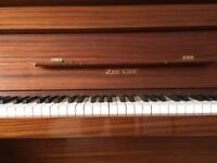 Zender upright piano for sale , dark wood effect , removal required .
