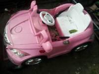 Girls pink ride on car