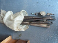 Two bags of drain clearing rods