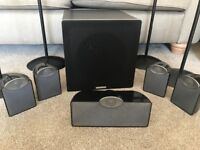 Home cinema speakers Tannoy back front and centre , Cambridge Audio sub and 4 stands.