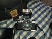 Olympus Om-10 with carry bad, flashes and lenses