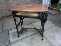 Old cast iron washing roller converted into table
