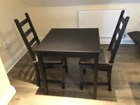 Black dinner table with 2 chairs