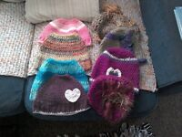 Various hand crocheted hats and messy bun hats