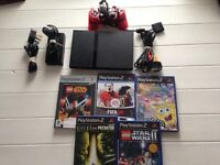 Sony PlayStation 2 slimline with 5 games