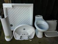 white ceramic shower tray, basin with pedestal and toilet.