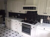 White Gloss Kitchen including Neff oven & 6 burner gas hob & integrated Siemens dishwasher