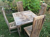 WOODEN TABLE AND 4 HIGH BACK CHAIRS