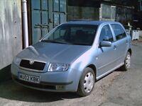 SKODA FABIA. 1.4 - 5 door hatch in blue grey metallc