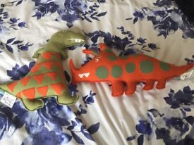 Dinosaur cushions from John Lewis