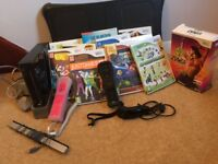 Wii console and 10 games and balance board