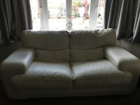 Selling 2 leather sofas in off white colour. Both in good used condition.