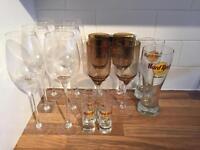 10 Wine Glasses, 2 Hard Rock Pint Glasses and 4 Shot Glasses