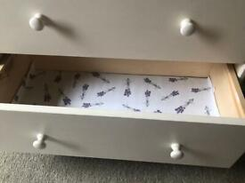 Two identical sets of drawers