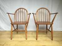 Pair of vintage low back Windsor Ercol armchairs carvers dining chairs