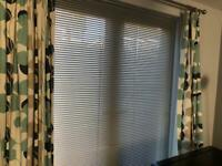 1 set of curtains and matching cushions