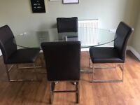 Dwell glass dining room table and 4 chairs