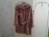 fur coat this beautiful coat is full lengh with small belt at the back, size 14 to 16